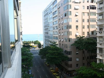 Photo for Large apartment 5/4 on Copacabana Beach on the corner