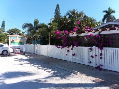 Bougainvillea on the south pergola. 2 parking spaces per unit.