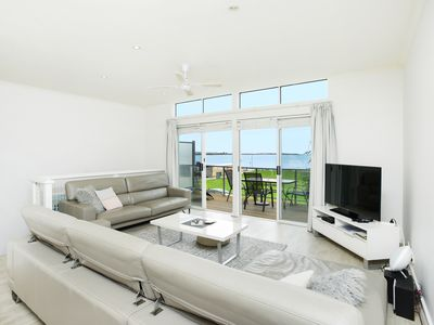Photo for Central, Modern and Beachfront!