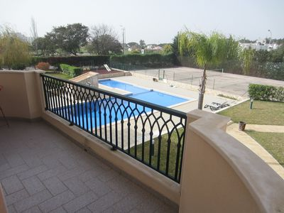 Photo for 2 bedroom apartment-closed condominium in Olhos de Agua with pool, garden and tennis