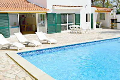 Pool area showing part of house with alpendre for outside covered eating