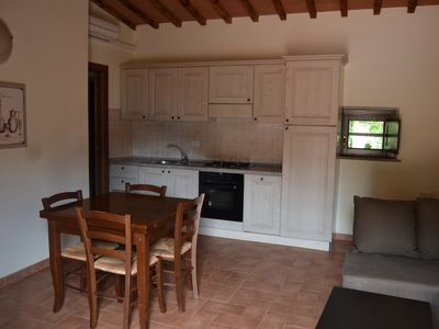 Photo for Villa in charming stone village with swimming pool, tennis, in the countryside near the sea and services.