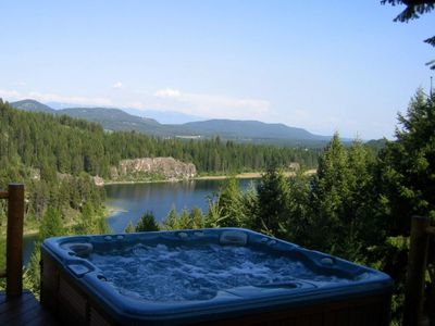 Photo for Relax in the hot tub overlooking the lake