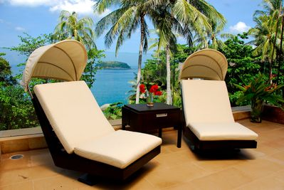 Designer chairs on the terrace at Baan Saleah
