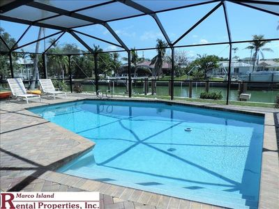 Photo for 1143 Edington; Bring your boat! Lovely 3 Bed, 2 Bath home with Heated Pool on Canal in Olde Marco. Snook Inn close by