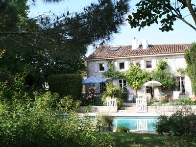 Photo for Charming mansion, heated swimming pool, 25 km far from the sea, pond, gardens