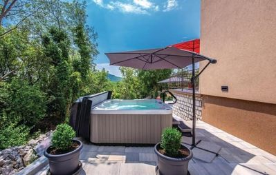 Photo for Holiday house with jacuzzi and barbecue in the garden