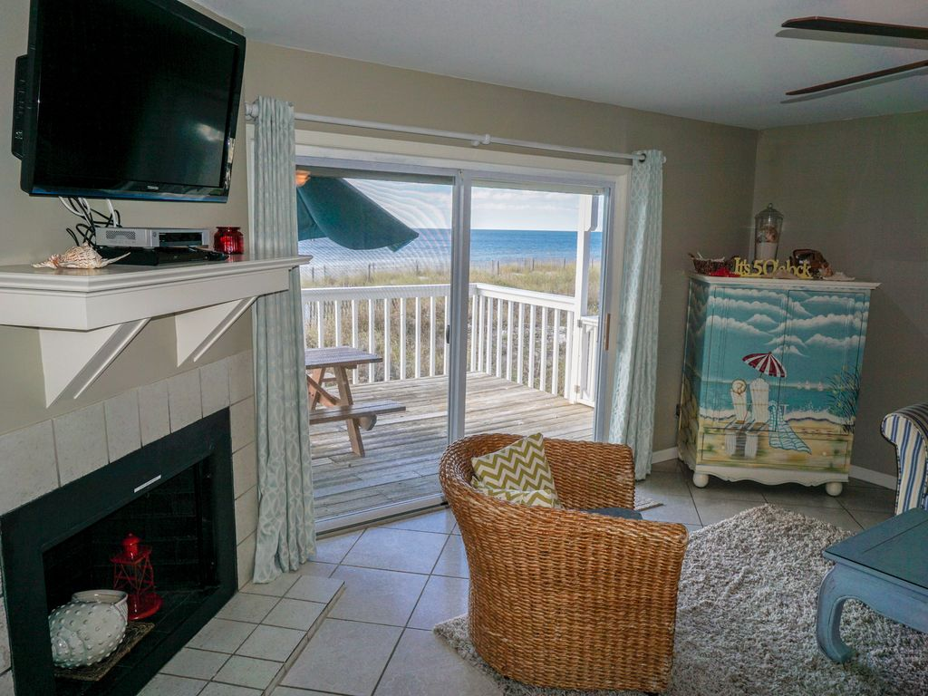 Living Area With Flat Screen Cable And DVD Along With Beachfront Deck.