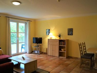 Photo for Spacious ground floor apartment with beautiful sun terrace - incl. Use of the hotel's own wellness area, underground parking and Wi-Fi access