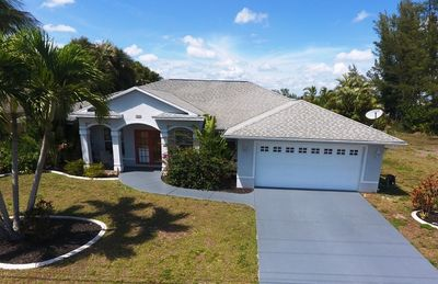 Photo for Paradise Found | Canal | Heated Pool | Cape Coral