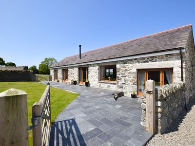 Photo for Beautiful and detached, this 5 star cottage offers a private 'swim spa' hot tub with a view, a woodb
