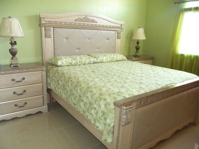Master bedroom has a king sized bed, 2 night stands, dresser and chest.
