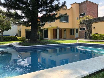 Photo for Beautiful family home with pool near the center