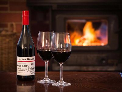 Relax and enjoy a nice glass of wine in front of the cosy wood fire in winter.