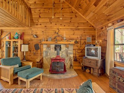 Photo for Secluded cabin with a front porch & wood stove - dogs welcome!