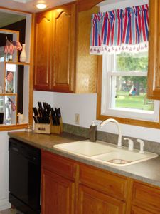 Kitchen. Shows dishwasher and knife sets.