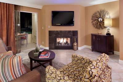 Take a seat in front of the fireplace and enjoy a movie in the living area.