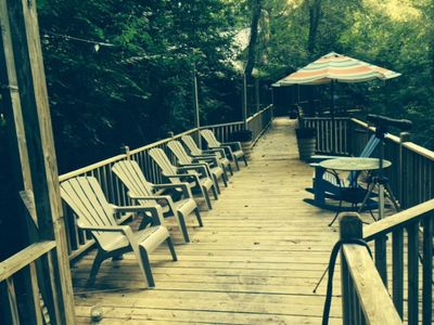The bridge and sitting area over a 60' high ravine to see wildlife and forest.