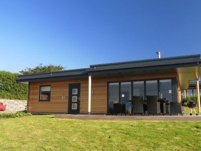 Photo for A stunning eco-home with cedar cladding, a sedum roof & state-of-the-art design.