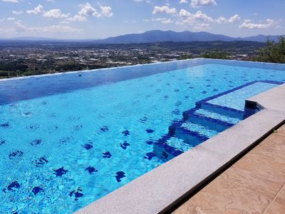 Photo for Original Farmhouse from 1790 with breathtaking views, infinity pool