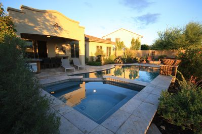 Backyard heaven!  Saltwater pool, spa, fire pit, bar, covered dining for 8.