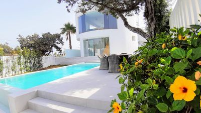 Photo for Stunning beachside new lounge villa with private heated pool & rooftop pool