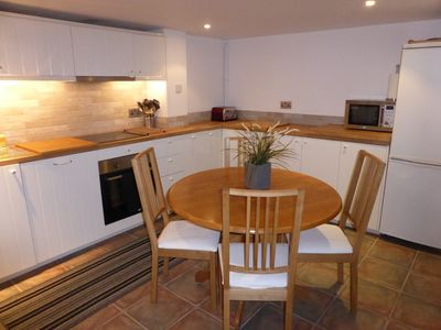 Dining kitchen showing oven , fridge freezer, toaster and microwave