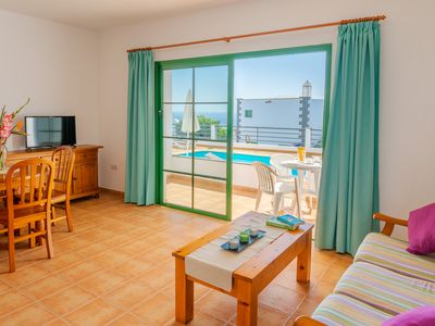 Photo for Beautiful apartment near the beach w/ shared pool, private terrace, & free WiFi