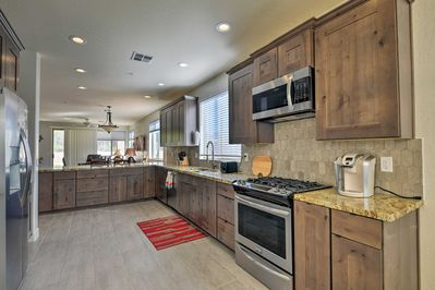 Stainless steel appliances and granite countertops elevate this kitchen.