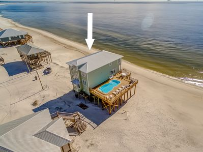 Located right on the Gulf Beach with a full size private pool and multiple decks