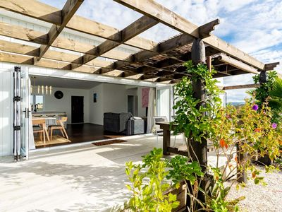 Photo for Tropical Oasis - Modern, sunny, fully fenced holiday home with beautiful tropical gardens