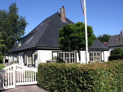 Photo for Traditional Dutch farmhouse dating from 1884 with the comfort of today, near the sea.