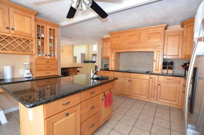 Gourmet kitchen with granite counter and high-end cabinets, two sinks