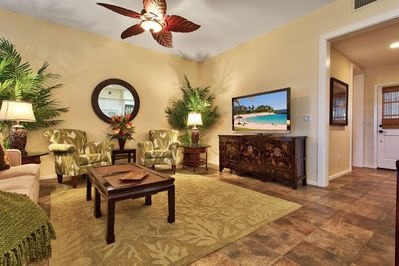 Beautiful living area with tropical decor, extra large flat screen TV & Blu-Ray