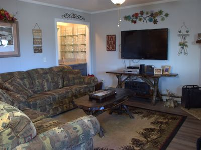 Photo for Let the good times roll with this rustic 2 bedroom condo on the first floor!