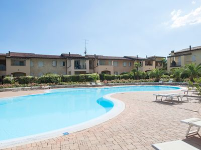"""Photo for Apartment """"Sirmione Summer Dream"""" in elegant resort with pool, close to the beach"""