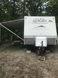 Front of camper, picnic table, outside carpet, 20' long awning