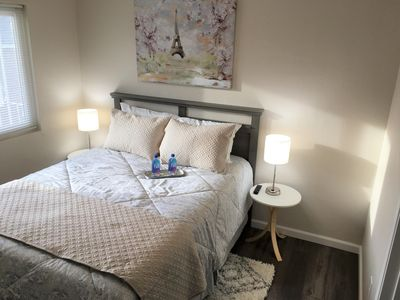 Comfy queen bed, TV with Netflix, Hulu, Disney+, and ESPN+, protable crib