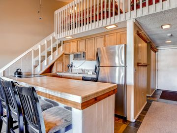 Cute condo in the heart of Breck, fireplace and balcony overlooking the Dredge!