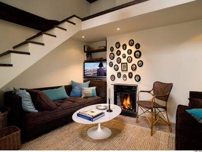 Duplex Living Room with catwalk & faux woodburning fireplace