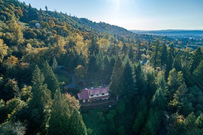 MapleRidge House sits atop the Lewis River Valley in 20 private acres of forest