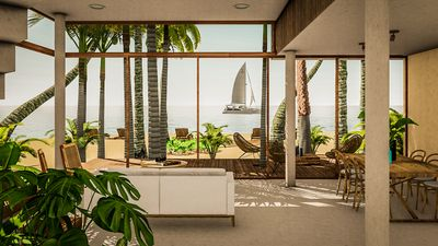 main floor open concept living space - large sliding doors open right to beach