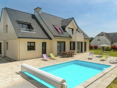 Photo for Breton villa with a private swimming pool, a garden and views of the sea and the beach