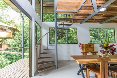 The dining area and spiral stairs to the living area and extra bedroom