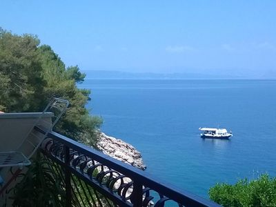 Photo for Two bedroom apartment with balcony and sea view Cove Pobij, Hvar (A-7506-b)