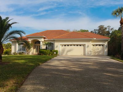 Photo for Luxury pool home minutes to the beach with beautiful gardens - Manasota 16