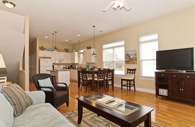 Open living, dining and kitchen areas.