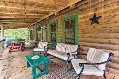 Relax on the furnished porch after a day of exploring.