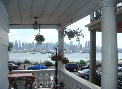 After a hectic day in Manhattan, relax in the porch with a glass of wine