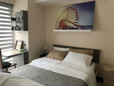 Photo for McKinley Condo with FIBR WIFI/Cable/Netflix, beside Venice Mall, near Airport